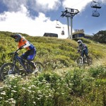 Downhill riders on the Abom Village Link track