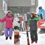 Jumping with joy! Snowflakes falling and ready to hit the slopes.